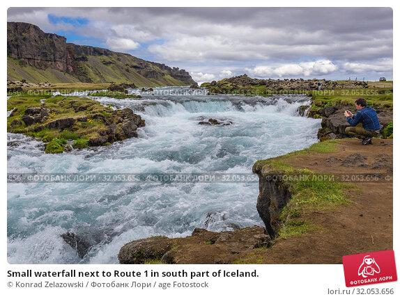 Small waterfall next to Route 1 in south part of Iceland. Стоковое фото, фотограф Konrad Zelazowski / age Fotostock / Фотобанк Лори