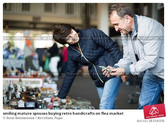 Купить «smiling mature spouses buying retro handicrafts on flea market», фото № 28514016, снято 23 октября 2017 г. (c) Яков Филимонов / Фотобанк Лори