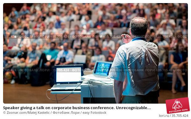 Speaker giving a talk on corporate business conference. Unrecognizable... Стоковое фото, фотограф Zoonar.com/Matej Kastelic / easy Fotostock / Фотобанк Лори
