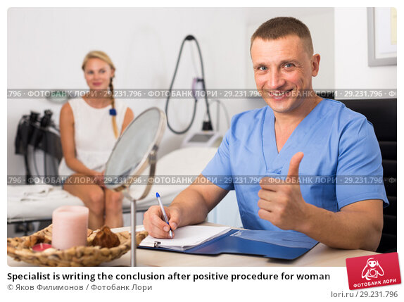 Specialist is writing the conclusion after positive procedure for woman. Стоковое фото, фотограф Яков Филимонов / Фотобанк Лори