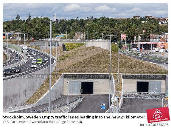 Stockholm, Sweden Empty traffic lanes leading into the new 21 kilometer... Стоковое фото, фотограф A. Farnsworth / age Fotostock / Фотобанк Лори