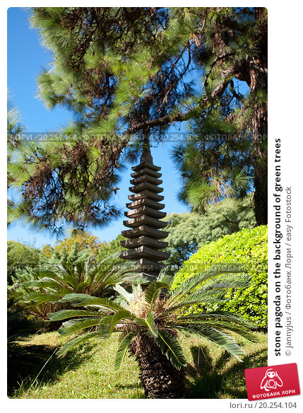 stone pagoda on the background of green trees. Стоковое фото, фотограф jannyjus / easy Fotostock / Фотобанк Лори