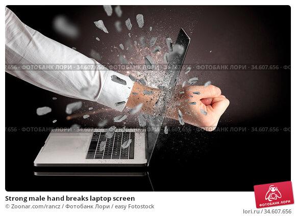 Strong male hand breaks laptop screen. Стоковое фото, фотограф Zoonar.com/rancz / easy Fotostock / Фотобанк Лори