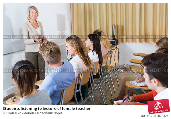 Students listening to lecture of female teacher. Стоковое фото, фотограф Яков Филимонов / Фотобанк Лори