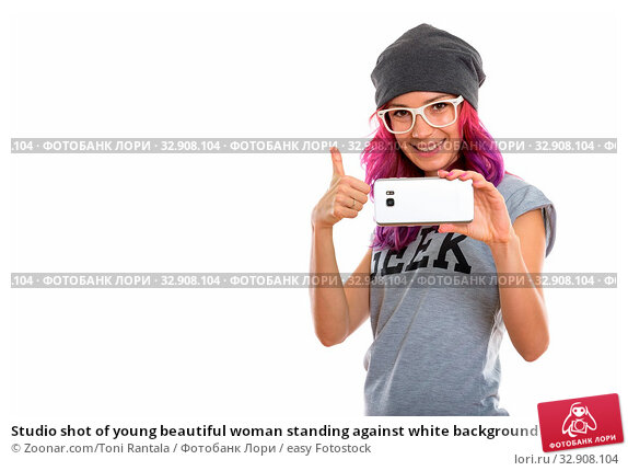 Studio shot of young beautiful woman standing against white background. Стоковое фото, фотограф Zoonar.com/Toni Rantala / easy Fotostock / Фотобанк Лори