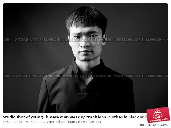 Studio shot of young Chinese man wearing traditional clothes in black and white. Стоковое фото, фотограф Zoonar.com/Toni Rantala / easy Fotostock / Фотобанк Лори
