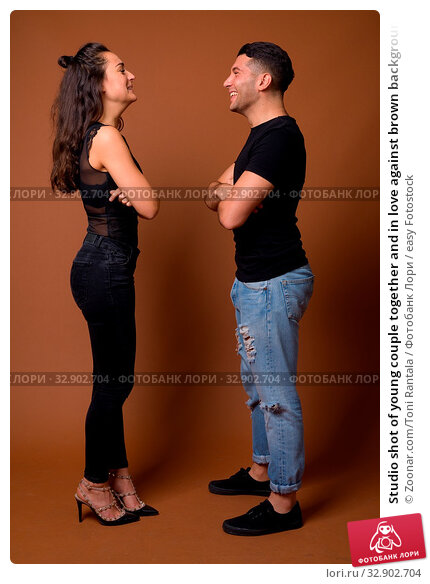 Studio shot of young couple together and in love against brown background. Стоковое фото, фотограф Zoonar.com/Toni Rantala / easy Fotostock / Фотобанк Лори