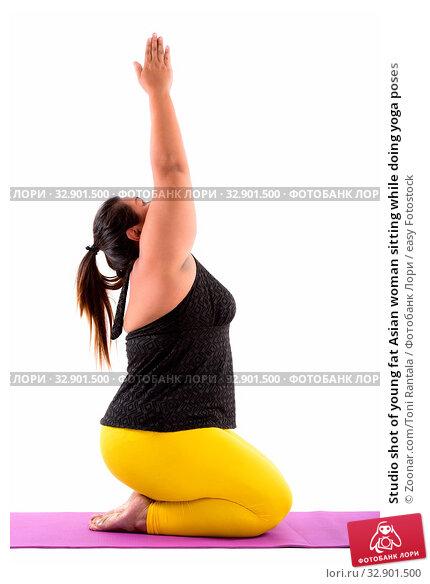 Studio shot of young fat Asian woman sitting while doing yoga poses. Стоковое фото, фотограф Zoonar.com/Toni Rantala / easy Fotostock / Фотобанк Лори