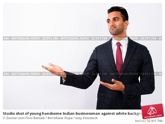 Studio shot of young handsome Indian businessman against white background. Стоковое фото, фотограф Zoonar.com/Toni Rantala / easy Fotostock / Фотобанк Лори