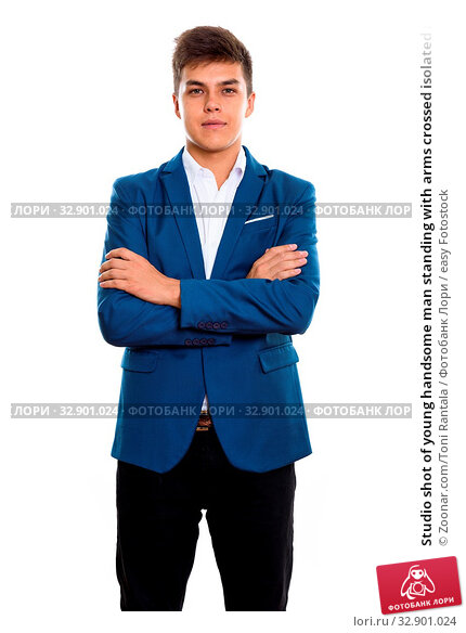 Studio shot of young handsome man standing with arms crossed isolated against white background. Стоковое фото, фотограф Zoonar.com/Toni Rantala / easy Fotostock / Фотобанк Лори