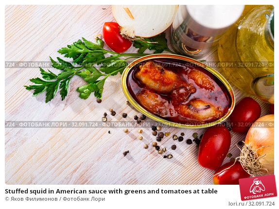 Купить «Stuffed squid in American sauce with greens and tomatoes at table», фото № 32091724, снято 27 февраля 2020 г. (c) Яков Филимонов / Фотобанк Лори