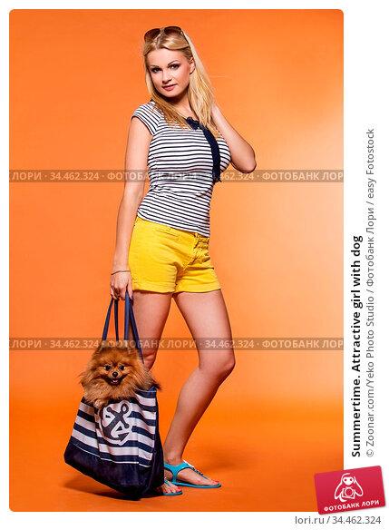 Summertime. Attractive girl with dog. Стоковое фото, фотограф Zoonar.com/Yeko Photo Studio / easy Fotostock / Фотобанк Лори