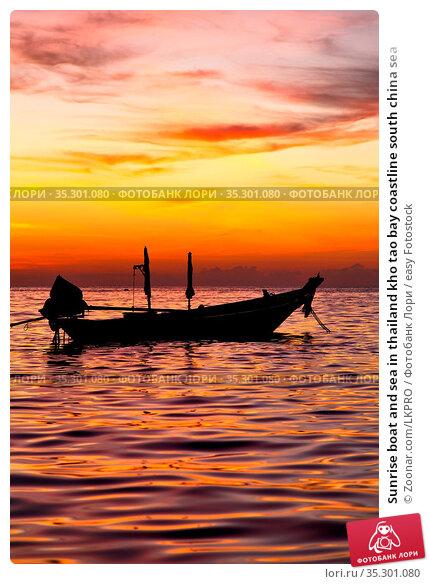 Sunrise boat and sea in thailand kho tao bay coastline south china sea. Стоковое фото, фотограф Zoonar.com/LKPRO / easy Fotostock / Фотобанк Лори
