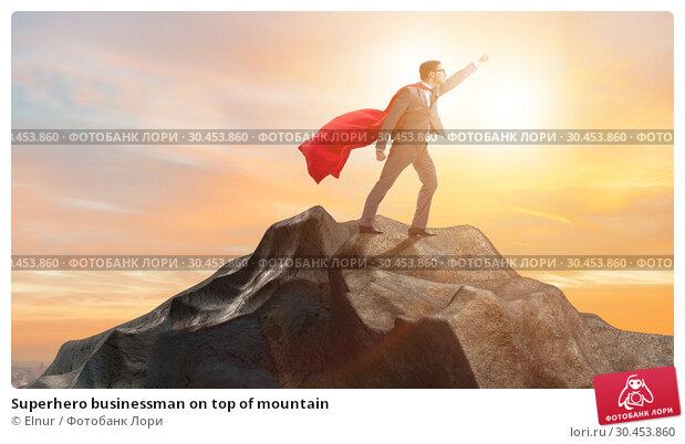 Superhero businessman on top of mountain. Стоковое фото, фотограф Elnur / Фотобанк Лори