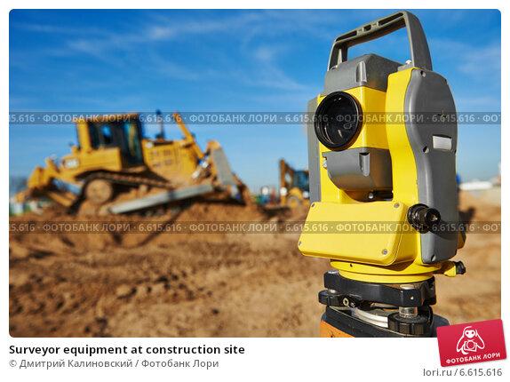 Купить «Surveyor equipment at construction site», фото № 6615616, снято 28 октября 2014 г. (c) Дмитрий Калиновский / Фотобанк Лори