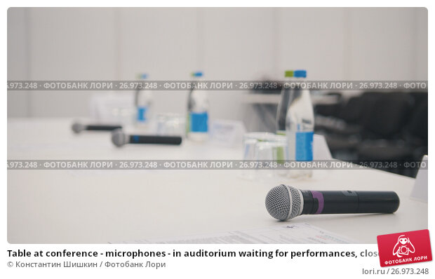 Купить «Table at conference - microphones - in auditorium waiting for performances, close up», фото № 26973248, снято 9 апреля 2019 г. (c) Константин Шишкин / Фотобанк Лори