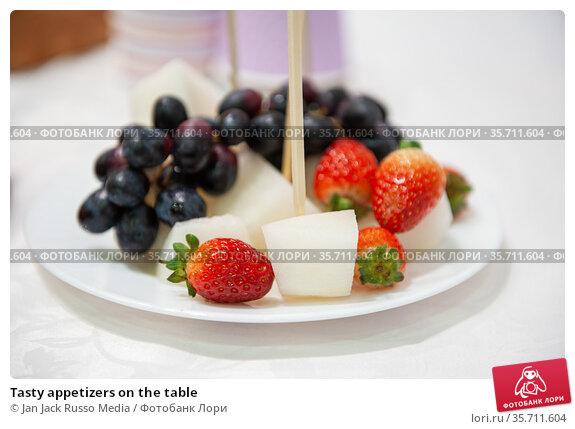 Tasty appetizers on the table. Стоковое фото, фотограф Jan Jack Russo Media / Фотобанк Лори
