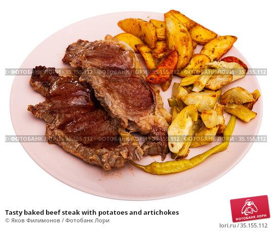 Tasty baked beef steak with potatoes and artichokes. Стоковое фото, фотограф Яков Филимонов / Фотобанк Лори