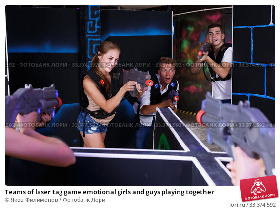 Купить «Teams of laser tag game emotional girls and guys playing together», фото № 33374592, снято 27 августа 2018 г. (c) Яков Филимонов / Фотобанк Лори