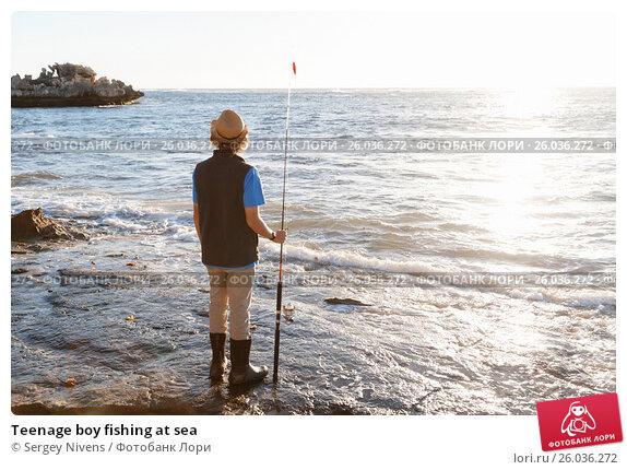 Teenage boy fishing at sea, фото № 26036272, снято 15 апреля 2015 г. (c) Sergey Nivens / Фотобанк Лори