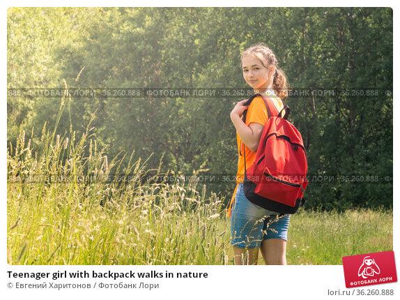 Teenager girl with backpack walks in nature. Стоковое фото, фотограф Евгений Харитонов / Фотобанк Лори