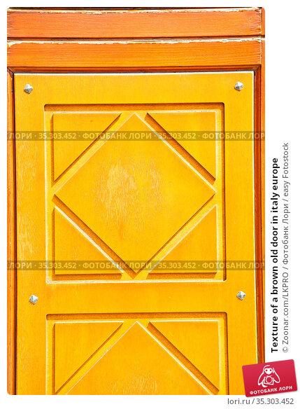 Texture of a brown old door in italy europe. Стоковое фото, фотограф Zoonar.com/LKPRO / easy Fotostock / Фотобанк Лори