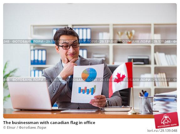 Купить «The businessman with canadian flag in office», фото № 29139048, снято 3 февраля 2017 г. (c) Elnur / Фотобанк Лори