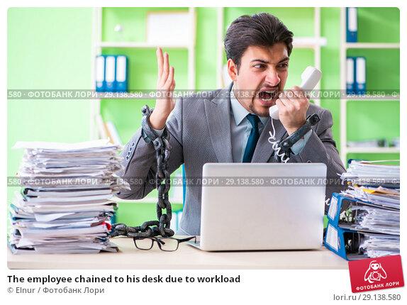 Купить «The employee chained to his desk due to workload», фото № 29138580, снято 11 мая 2018 г. (c) Elnur / Фотобанк Лори