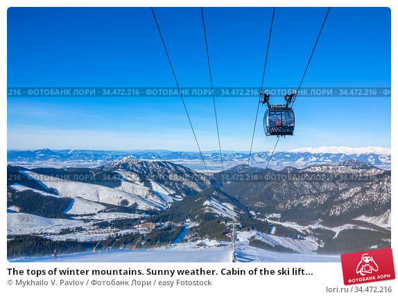 The tops of winter mountains. Sunny weather. Cabin of the ski lift... Стоковое фото, фотограф Mykhailo V. Pavlov / easy Fotostock / Фотобанк Лори