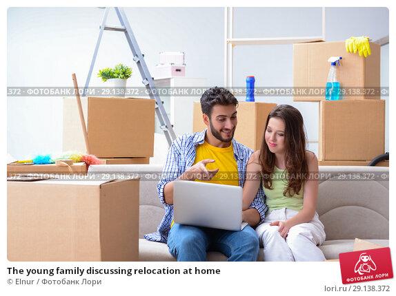 Купить «The young family discussing relocation at home», фото № 29138372, снято 10 июля 2017 г. (c) Elnur / Фотобанк Лори