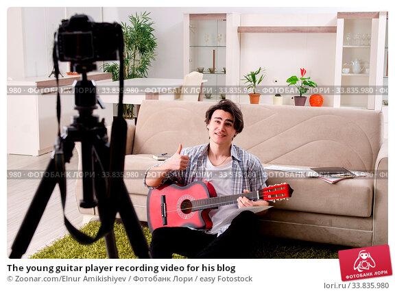 Купить «The young guitar player recording video for his blog», фото № 33835980, снято 26 мая 2020 г. (c) easy Fotostock / Фотобанк Лори