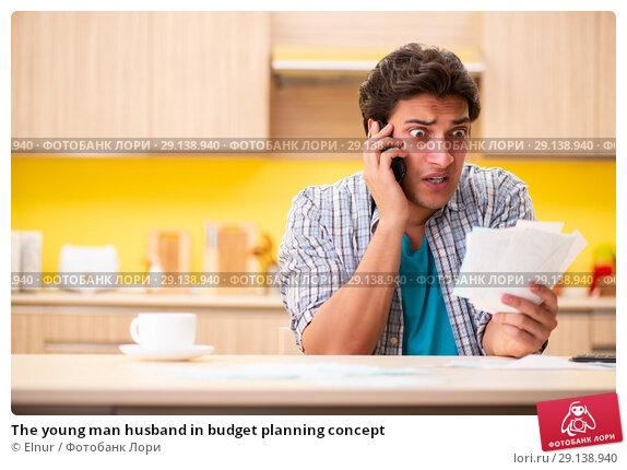 Купить «The young man husband in budget planning concept», фото № 29138940, снято 13 июня 2018 г. (c) Elnur / Фотобанк Лори