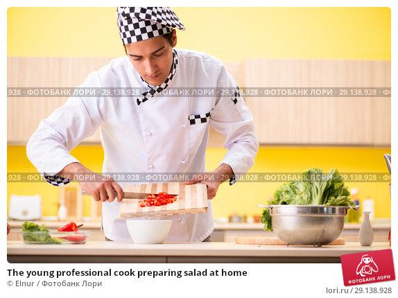 Купить «The young professional cook preparing salad at home», фото № 29138928, снято 13 июня 2018 г. (c) Elnur / Фотобанк Лори