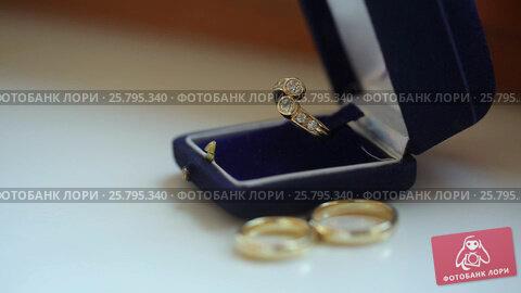 Купить «Three wedding rings», видеоролик № 25795340, снято 16 марта 2016 г. (c) Алексей Макаров / Фотобанк Лори