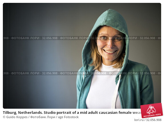 Tilburg, Netherlands. Studio portrait of a mid adult caucasian female wearing a hoody. Стоковое фото, фотограф Guido Koppes / age Fotostock / Фотобанк Лори