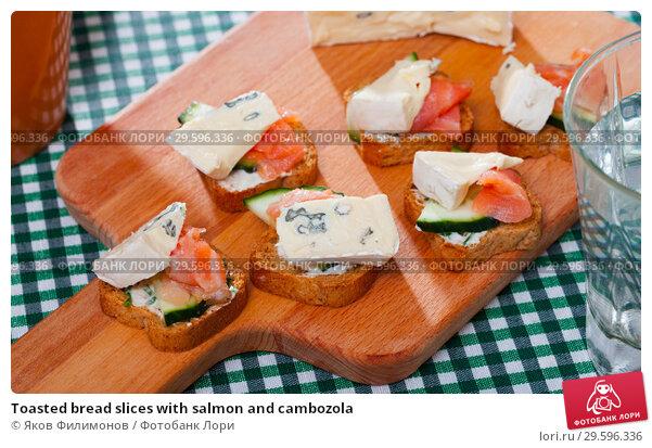 Купить «Toasted bread slices with salmon and cambozola», фото № 29596336, снято 18 февраля 2019 г. (c) Яков Филимонов / Фотобанк Лори