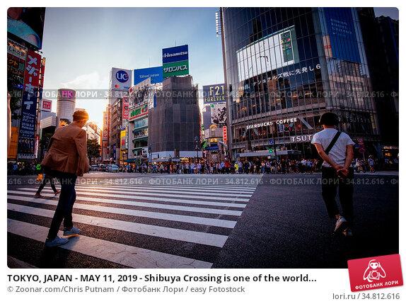 TOKYO, JAPAN - MAY 11, 2019 - Shibuya Crossing is one of the world... Стоковое фото, фотограф Zoonar.com/Chris Putnam / easy Fotostock / Фотобанк Лори