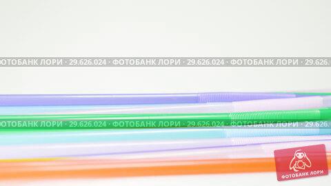 Купить «Top view of colorful straw on the rotation table», видеоролик № 29626024, снято 27 мая 2019 г. (c) Dzmitry Astapkovich / Фотобанк Лори