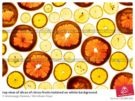 top view of slices of citrus fruits isolated on white background. Стоковое фото, фотограф Александр Иванов / Фотобанк Лори