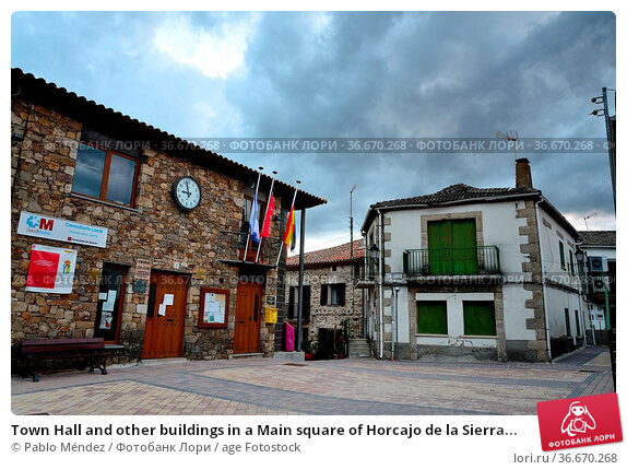 Town Hall and other buildings in a Main square of Horcajo de la Sierra... Стоковое фото, фотограф Pablo Méndez / age Fotostock / Фотобанк Лори