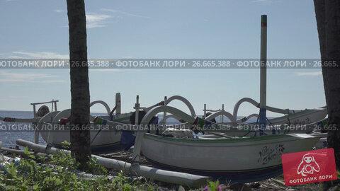 Купить «Tradichionny boats of fishermen on seashore and fishing tackles, Bali. Indonesia», видеоролик № 26665388, снято 15 июля 2009 г. (c) Куликов Константин / Фотобанк Лори