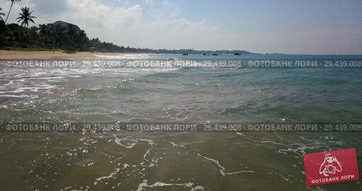 Купить «Tropical landscape of sand beach and sea waves rolling in», видеоролик № 29439008, снято 8 ноября 2018 г. (c) Andriy Bezuglov / Фотобанк Лори