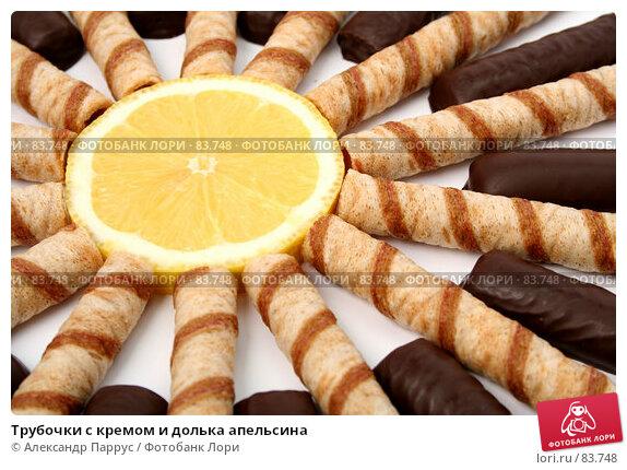 Трубочки с кремом и долька апельсина, фото № 83748, снято 9 января 2007 г. (c) Александр Паррус / Фотобанк Лори