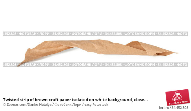 Twisted strip of brown craft paper isolated on white background, close... Стоковое фото, фотограф Zoonar.com/Danko Natalya / easy Fotostock / Фотобанк Лори
