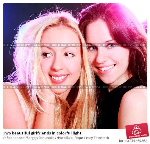 Two beautiful girlfriends in colorful light. Стоковое фото, фотограф Zoonar.com/Sergejs Rahunoks / easy Fotostock / Фотобанк Лори