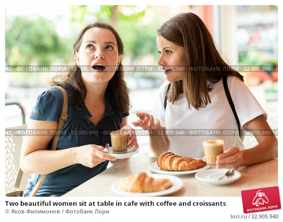 Two beautiful women sit at table in cafe with coffee and croissants. Стоковое фото, фотограф Яков Филимонов / Фотобанк Лори