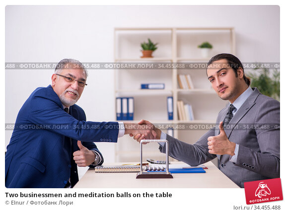 Two businessmen and meditation balls on the table. Стоковое фото, фотограф Elnur / Фотобанк Лори