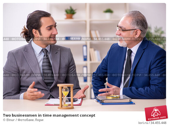 Two businessmen in time management concept. Стоковое фото, фотограф Elnur / Фотобанк Лори