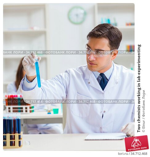 Two chemists working in lab experimenting. Стоковое фото, фотограф Elnur / Фотобанк Лори
