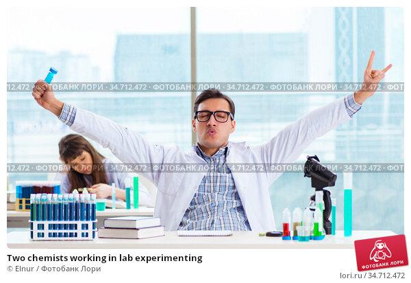 Two chemists working in lab experimenting. Стоковое фото, фотограф Elnur / Фотобанк Лори